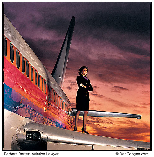 Barbara Barrett, Aviation Lawyer, standing on the wing of an airplane